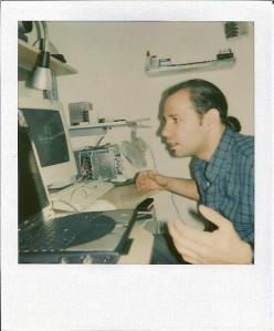 John working at the spliced-together computer